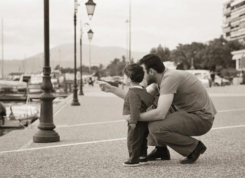 Thoughtful Father and Child Photo