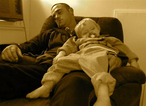 Softly Sleeping Father and Child Photo