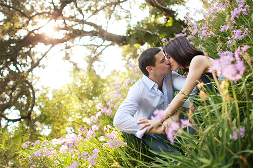 Flower grass nature kissing couple engagement photography