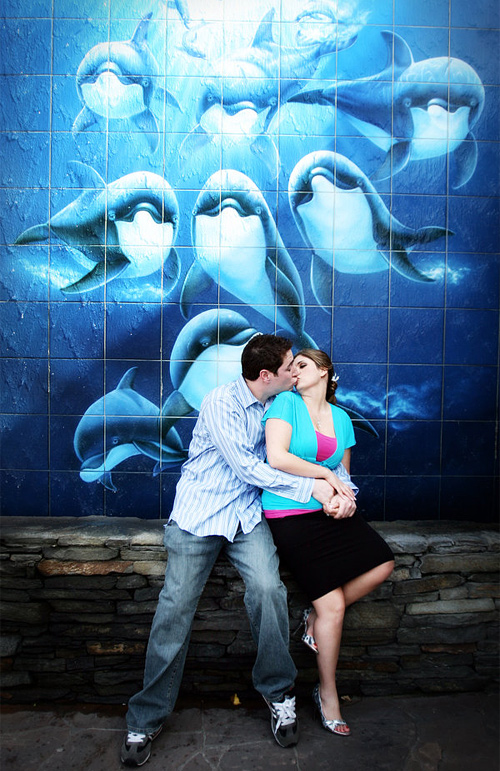 Dolphin kissing couple engagement photography
