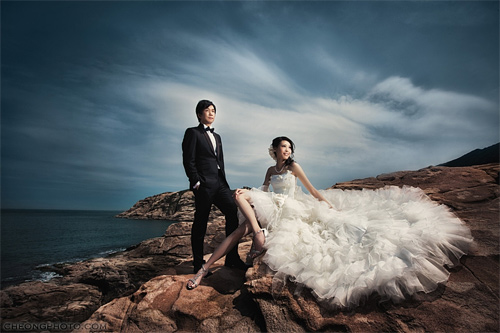 Pre wedding beach rock couple engagement photography