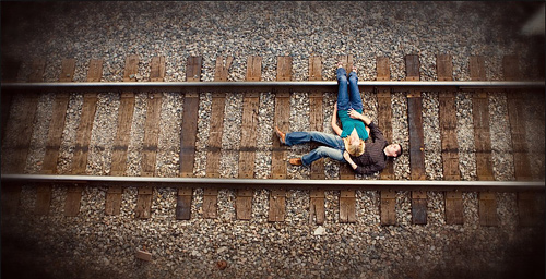 Train rail lying couple engagement photography