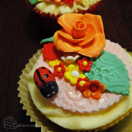 Flower lady bug cupcake design inspiration