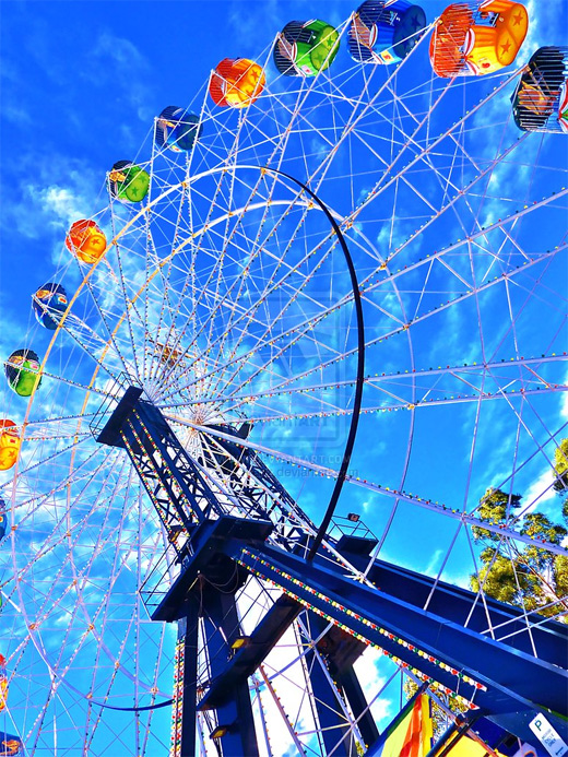 Colorful blue sky ferris wheel photography