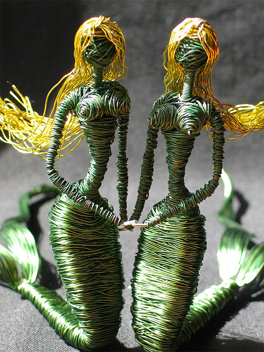Green mermaid wire sculpture