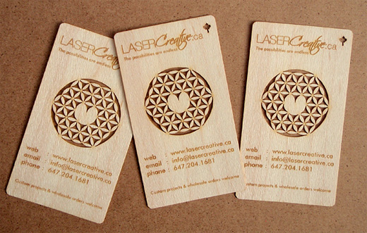 A collection of creative wooden business cards naldz graphics a complex and impressive cut out design which is achieved through laser cutting colourmoves