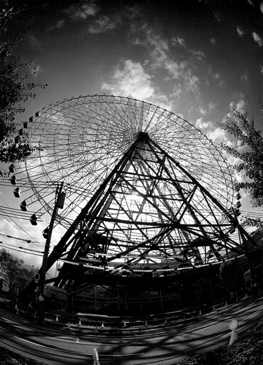 Black and white fisheye ferris wheel photography