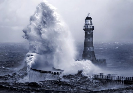 Wave smashing lighthouse photography