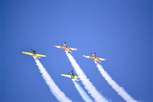 Yellow orange plane aircraft aerobatic photography