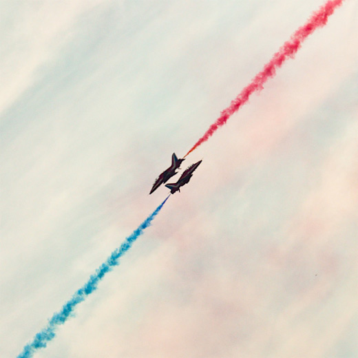 Red blue smoke diagonal aerobatic airplane aircraftphotography