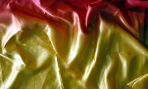 red and yellow satin fabric