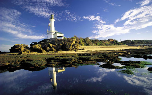 fantastic lighthouse reflected wallpaper