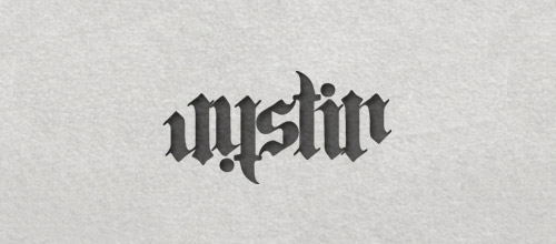 Justin ambigram logo design